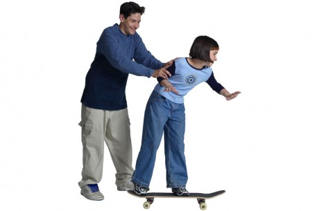 Two young people skateboarding